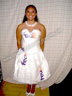 She was wearing a wedding dress and stuck stamps all over the dress