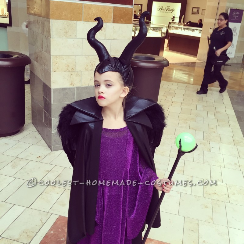 The pose. She loves acting the part with her Maleficent Costume.